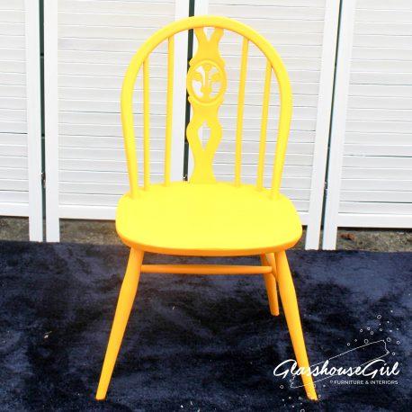 Glasshouse-Girl-Yellow-Ercol-Fleur-de-Lys-Chair-1
