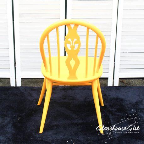 Glasshouse-Girl-Yellow-Ercol-Fleur-de-Lys-Chair-5